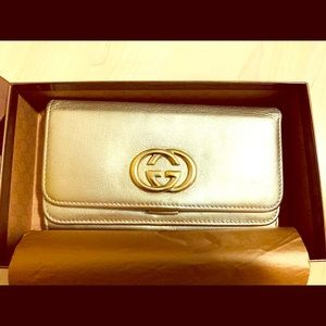 Gucci matallic gold continental wallet